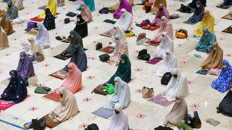 Socially distanced prayers in Indonesia